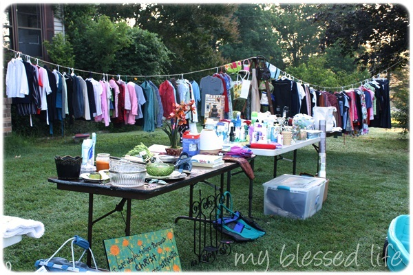 10 Yard Sale Tips {How To Have An Amazing Yard Sale!} How To Hang Clothes At A Garage Sale on homemade round clothes rack for garage sale, ghetto garage sale, yard sale, ideas for garage to hang clothes on sale,